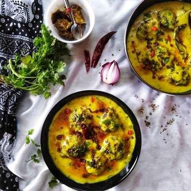 Photo of Punjabi kadhi with baked pakora by Debjani Dutta at BetterButter