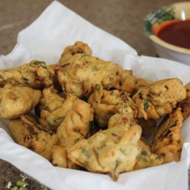 Photo of Sprouted Moong and Onion Fritters by Aarti Sharma at BetterButter