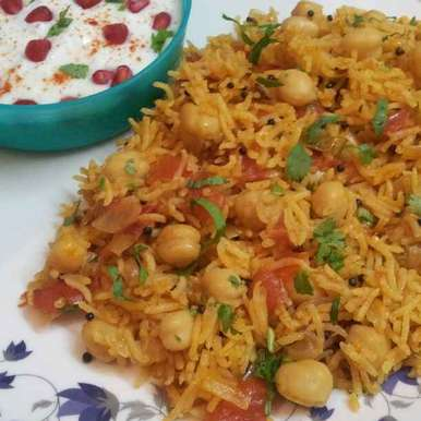 Photo of Tomato Rice with Chickpeas by Anjali Suresh at BetterButter