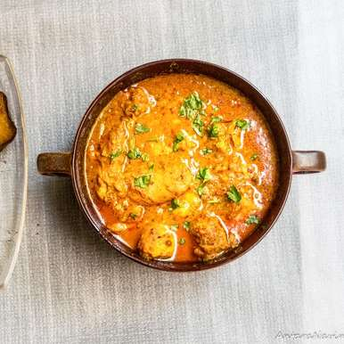 Photo of Murgh Malvani or chicken cooked in spicy gravy made with flavour of malvani masala by Antara Navin at BetterButter