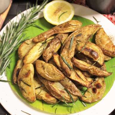 Photo of Rosemary Flavoured Baked Potato Wedges by Bethica Das at BetterButter