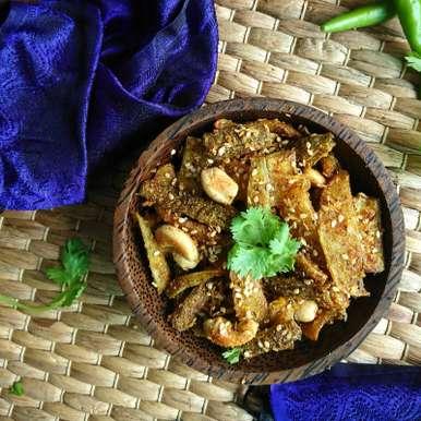Photo of Kaju Karela nu Shaak Recipe (Bitter Gourd and Cashew Stir Fry Dry Vegetable) by Drashti Dholakia at BetterButter