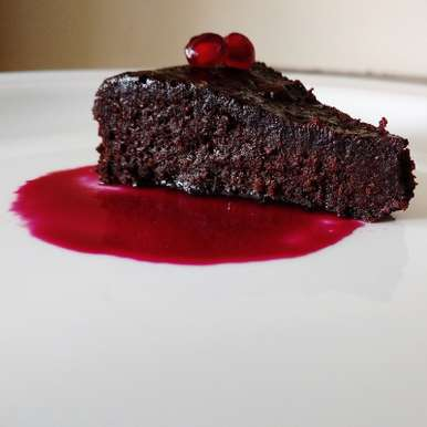 Photo of Flour less chocolate cake with pomegranate sauce by Flours Frostings at BetterButter