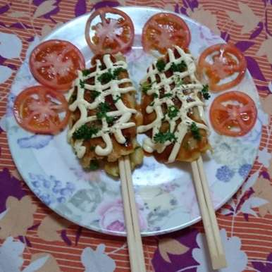 Photo of Cheesy-Veggie roll on chopsticks :) by Iman Jariwala at BetterButter