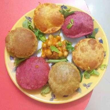 Photo of Colourful puri by kamala shankari at BetterButter