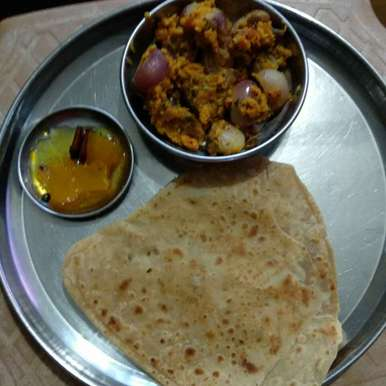 Photo of Stuffed onion subji and triangle . by Kavi Nidhida at BetterButter