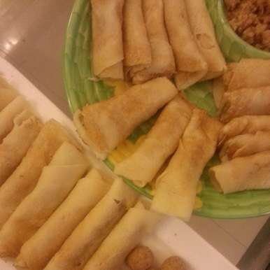 Photo of Pati Shapta (Coconut Crepes) by Madhurima Bose at BetterButter