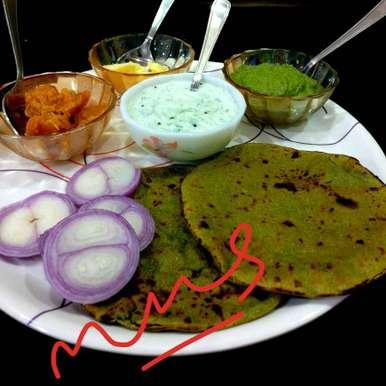 Photo of Fresh Green Garlic and Spinach Bajra Rotla.( With cucumber raita and green chutney ) by Manisha Shukla at BetterButter