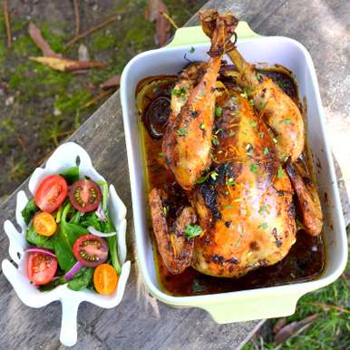 Photo of Cuban Roast Chicken with Spinach & Cherry Tomato Salad by Naina Puthran at BetterButter