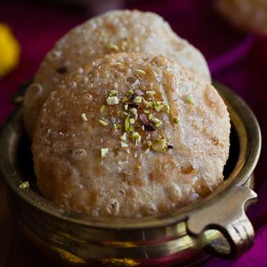 Photo of Kayi Puri- Coconut and jaggery stuffed puris by Nandita Shyam at BetterButter