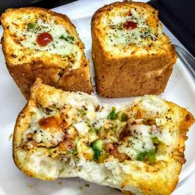Photo of Cheesey stuffed garlic buns by Neeru Goyal at BetterButter