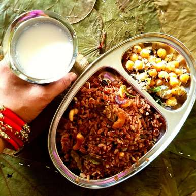 Photo of Red rice Tamarind Poha by Neeru Srikanth at BetterButter