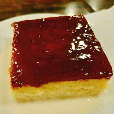 Photo of Eggless Curd cake(with honey & fruit jam topping) by Pravallika Srinivas at BetterButter