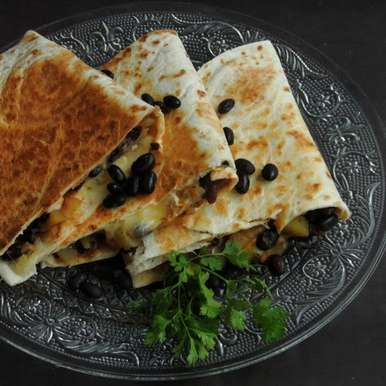 Photo of Cheesy Black Beans & Potato Quesadillas by Priya Suresh at BetterButter