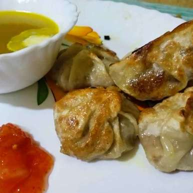 Photo of Pan fried momo with chicken clear soup by Priyanka Chakroborty at BetterButter