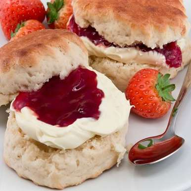 Photo of Cream Scones with strawberries and cream by BetterButter Editorial at BetterButter