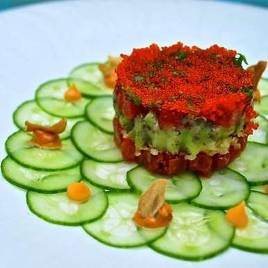 Photo of Tuna tartare with avocado, orange tobikko and yuzu sesame dressing by Pan Asian  at BetterButter