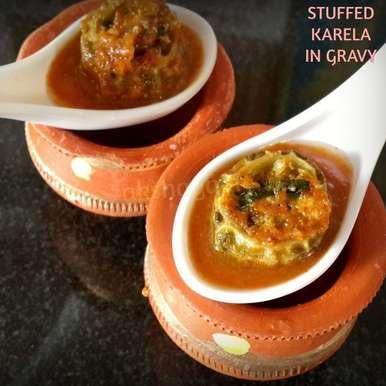 Photo of Stuffed Karela in gravy by Krithika Chandrasekaran at BetterButter