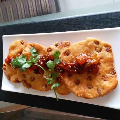 Photo of Chana studded kachori with sweet sour tomato chutney by Rajni Gupta Anand at BetterButter