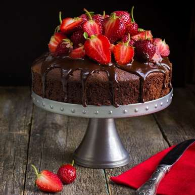 Photo of Chocolate Pound Cake with Chocolate Cream and Fresh Strawberries by Ruchira Hoon at BetterButter