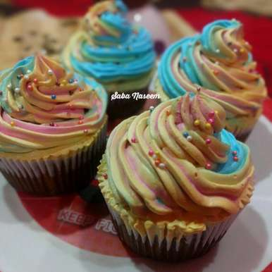 Photo of Eggless Rainbow Chocolate Cupcakes by Saba Naseem at BetterButter