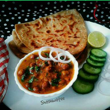 Photo of Shahi kala chana masala(black chickpea) with ajwain paratha by Shashwatee Swagatica at BetterButter