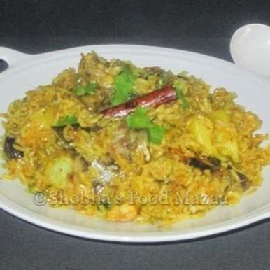 Muri Ghonto ( Bengali Recipe Of Fish Head Cooked With Rice And Spices )