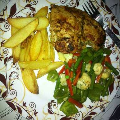 Photo of Pan tossed chicken , with sauted veggies and potato wedges. by Shraddha Pathak at BetterButter