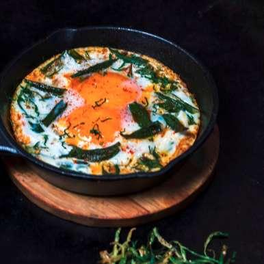 Photo of Bheeda Par Eeda – Eggs baked over okra by Soda Bottle Opener Wala  at BetterButter
