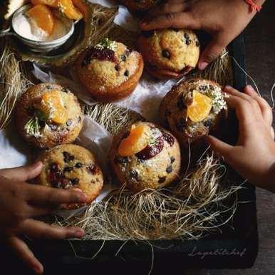Photo of Orange Muffins with Chocolate and Poppy seeds by Swayampurna Singh at BetterButter