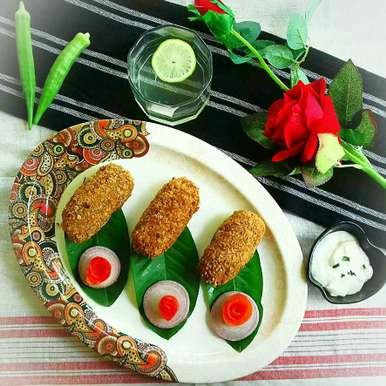 Photo of Soya stuffed oats coated fried cabbage roll by Tamali Rakshit at BetterButter