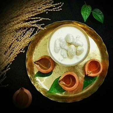 Photo of Bengali Doodh Puli (coconut-semolina dumplings in sweet milk) by Tamali Rakshit at BetterButter