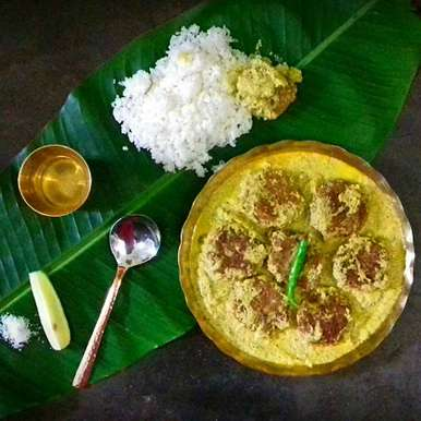 Photo of Prawn fritters in coconut gravy (Chingri Borar Malai Curry) by Tamali Rakshit at BetterButter