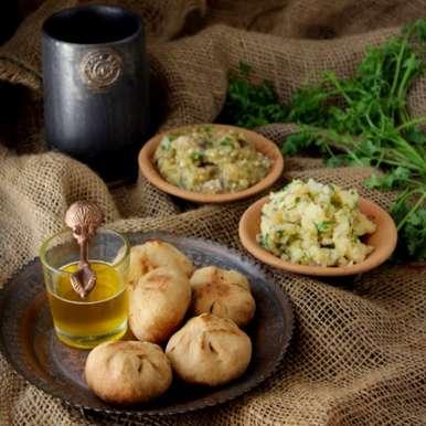 Photo of Litti Chokha (Chick pea Flour stuffed Balls w/ Potato Mash & Eggplant Mash) by Taruna Deepak at BetterButter