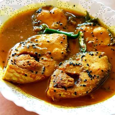 Photo of Iilish tel jhal/ Hilsa fish in mustard oil gravy by Tulika Biswas at BetterButter