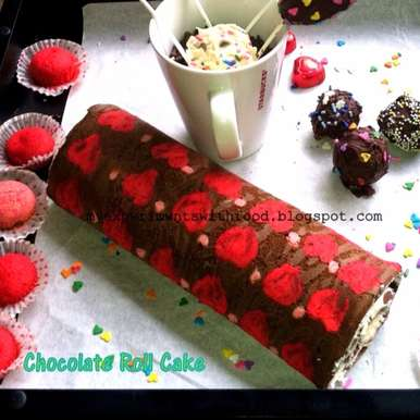Photo of Chocolate Roll Cake with Cute Little Hearts and Polka Dots by Zareena Siraj at BetterButter